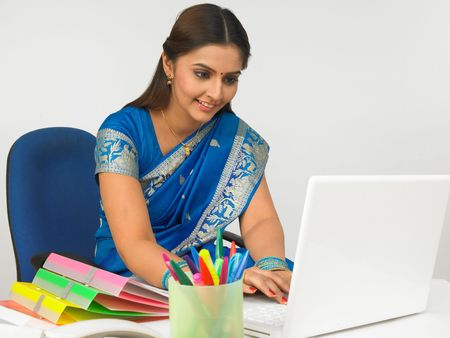 indian blue: asian business executive working in her office