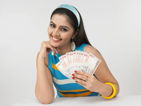 indian money: a gorgeous asian female of indian origin with currency notes