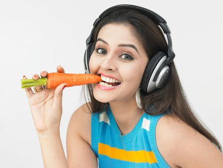 asian woman eating a carrot photo