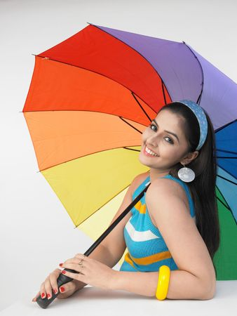 long silky hair: asian woman with a rainbow umbrella Stock Photo
