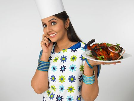 asian female chef talking on her cell phone photo