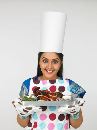 asian lady chef with her roasted chicken Stock Photo