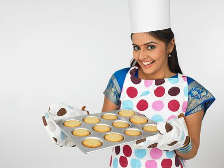 asian female baker with cookies photo