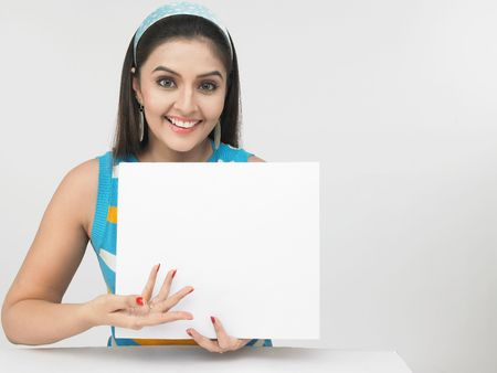 holding head: asian female with a blank placard Stock Photo