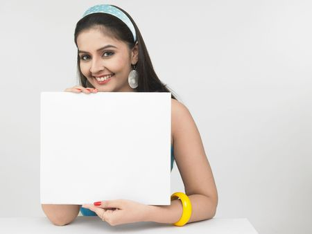 elbow band: asian female with a blank placard Stock Photo