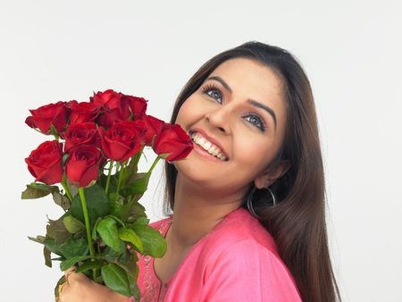 asian lady with a bouquet of red roses photo