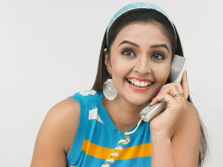 ear phones: asian girl talking on her cell phone