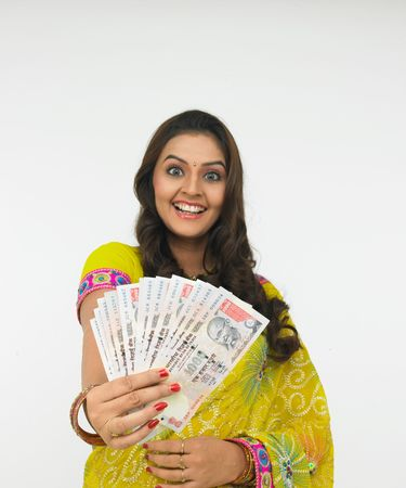 indian money: asian woman with a bunch of currency notes Stock Photo