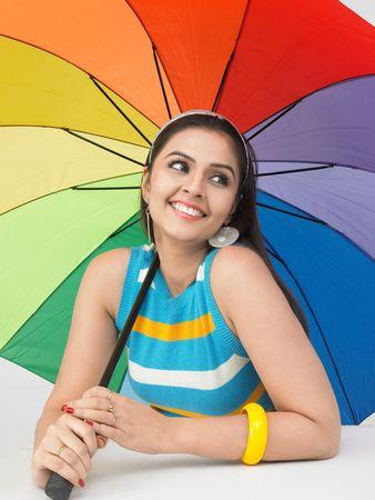 asian woman with a rainbow umbrella photo