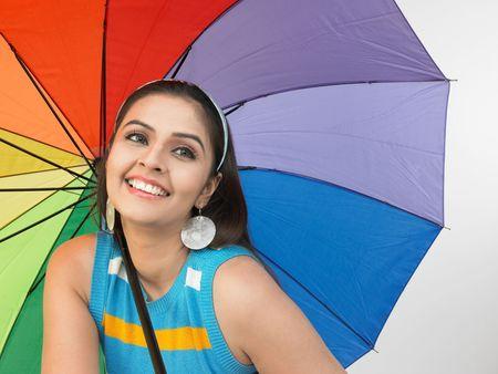 rainbow umbrella: asian woman with a rainbow umbrella Stock Photo