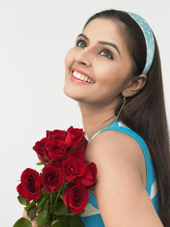 asian girl with a bunch of roses Stock Photo - 4282894