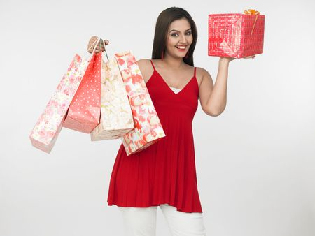 asian female with shopping bags Stock Photo - 4282520