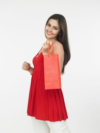 asian female with a shopping bag Stock Photo - 4282440