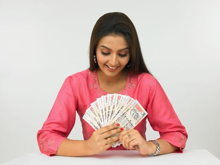 indian youth: asian woman with currency notes