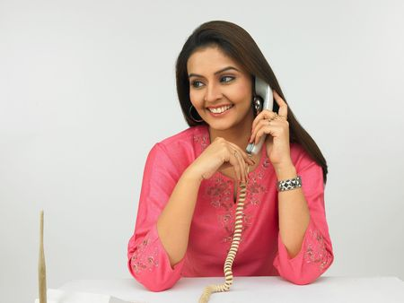 long silky hair: asian female executive talking on the phone Stock Photo