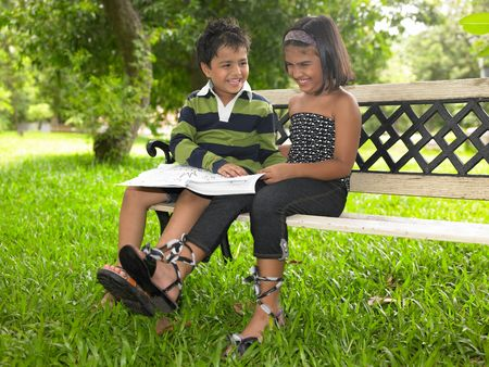 foot model: Asian girl & boy in a park Stock Photo