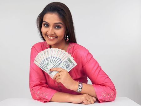 indian money: asian lady with indian currency notes Stock Photo