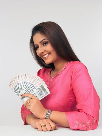 indian money: asian woman with currency notes
