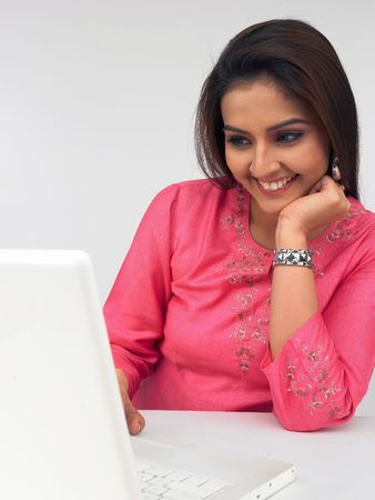 asian woman executive working in her laptop photo