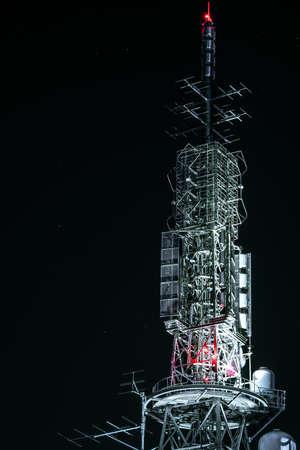 A radio tower that illuminates the night 写真素材