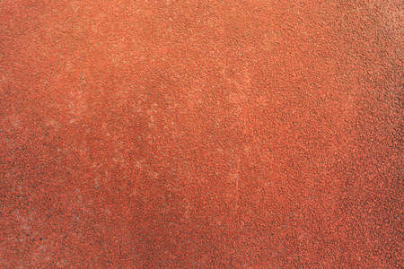 Treadmill surface athletics. The surface of crumb rubber pellets in treadmill athletics field background.background
