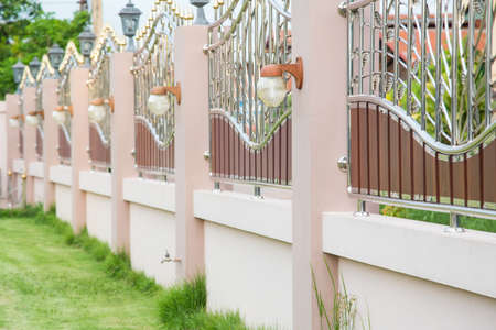 Solid Privacy stainless steel fence luxurious contemporary decorative light fixtures. Fence With Gate Stockfoto