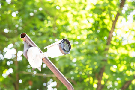 CCTV cameras are installed in the garden beautiful natural green background blurred..Outdoor Security cctv cameras