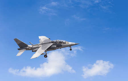 Military Fighter Jet on blue sky. Alpha Jet is a high potential fighter. Archivio Fotografico