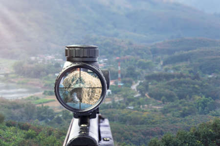 rifle target view on Natural Background. Image of a rifle scope sight used for aiming with a weapon 写真素材