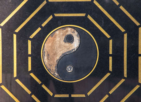 Yin Yang symbol. carved on black marble, yin yang, golden edge, Chinese symbol