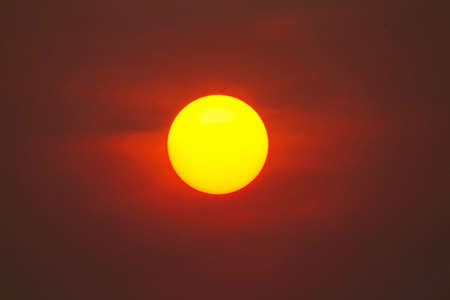 Bright big sun on the sky with yellow orange gradient colors. Picture Close Up The sun is used as a background for graphic work. 版權商用圖片