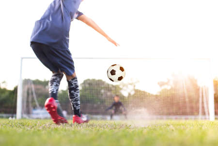 team soccer footballer get the ball to free kick or penalty kick during match in the stadium Stockfoto - 128849384