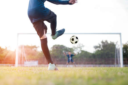 team soccer footballer get the ball to free kick or penalty kick during match in the stadium Stockfoto - 128850294
