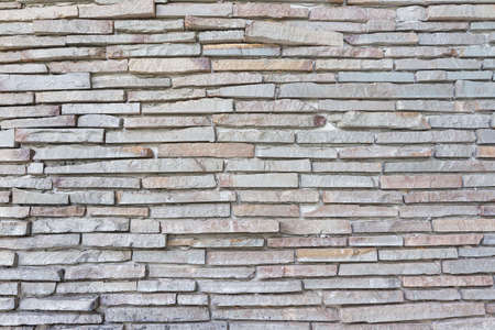 pattern of decorative white slate stone wall surface. Surface white wall of stone wall gray tones for use as background. Stock Photo