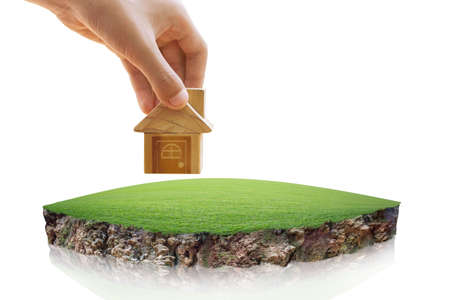 House symbol and Empty dry cracked swamp reclamation soil, land plot for housing construction project. round soil ground cross section with earth land, fantasy floating island with natural on the rock 版權商用圖片