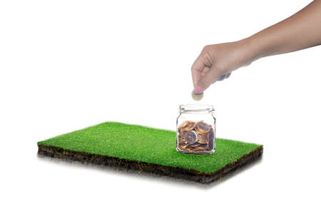 Mix coins in clear bottle isolated on white background, Business investment growth concept, round soil ground cross section with earth land and green grass, realistic rectangle cutaway terrain floor