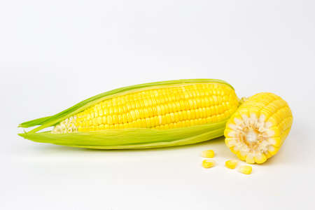 The peeled ear of corn, a piece of and seeds on a white, isolated as package design element Archivio Fotografico