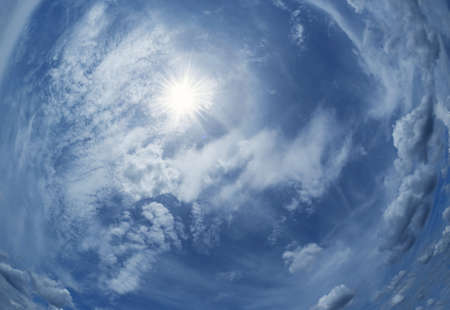 Sunny background, blue sky with white clouds and sun. The natural blue background has a breeze on a bright day in the summer.The sky and clouds are not the same shape as the weather.