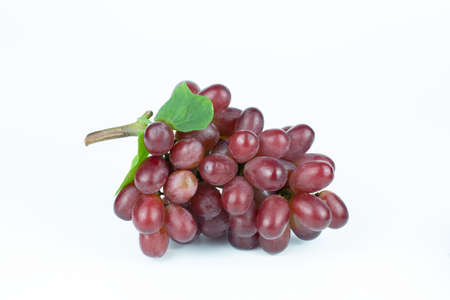 Ripe red grape. Pink bunch with leaves isolated on white. Vitis vinifera 免版税图像