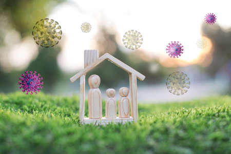 wooden doll couple stand in house model, self-quarantine and stay safe at home concept for Coronavirus, 2019-NCOV or COVID19 prevention, Stay home during the coronavirus  epidemic.