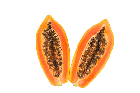 whole and half of ripe papaya fruit with seeds isolated on white background. Tropical nature fruits summer concept