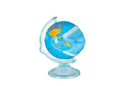 Earth globe in sterile medical mask. world medical concept,coronavirus epidemic in the world,global quarantine concept,earth in medical mask isolated on white background.