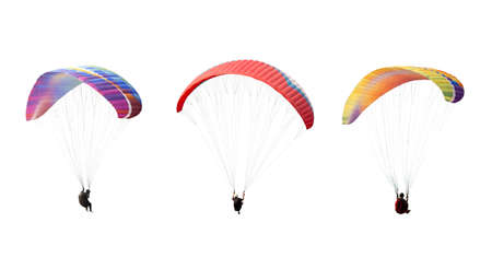 collection Bright colorful parachute isolated on white background,  The sportsman flying on a paraglider. Concept of extreme sport, taking adventure challenge.