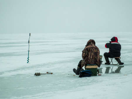 volga river: Ice fishing in Central Russia on the Volga river Stock Photo
