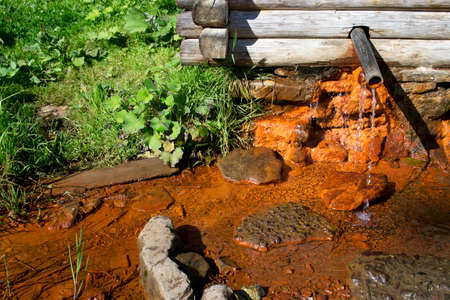 therapy geothermal: Mineral water spring in Ukraine  Carpathians   Stock Photo