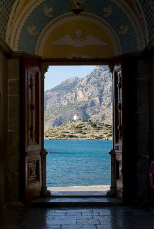 Looking through open door on the mountain. Symi. Greece. photo