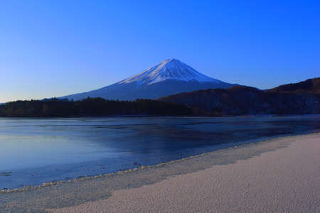 Mt. Fuji Midwinter on the Shore that freezes from Lake Kawaguchi Japan