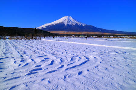 Mt.Fuji of snowy blue sky from Oshino Village Japan