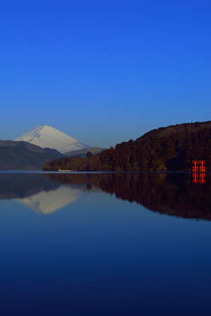 Inverted Mt. Fuji and the Torii of Peace with Blue sky sunny from Lake Ashi Hakone Japan 02 / 09 / 2018