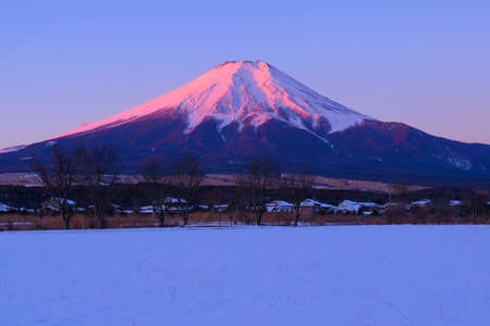 Mount Fuji of winter morning of snowy land from Oshino village Japan